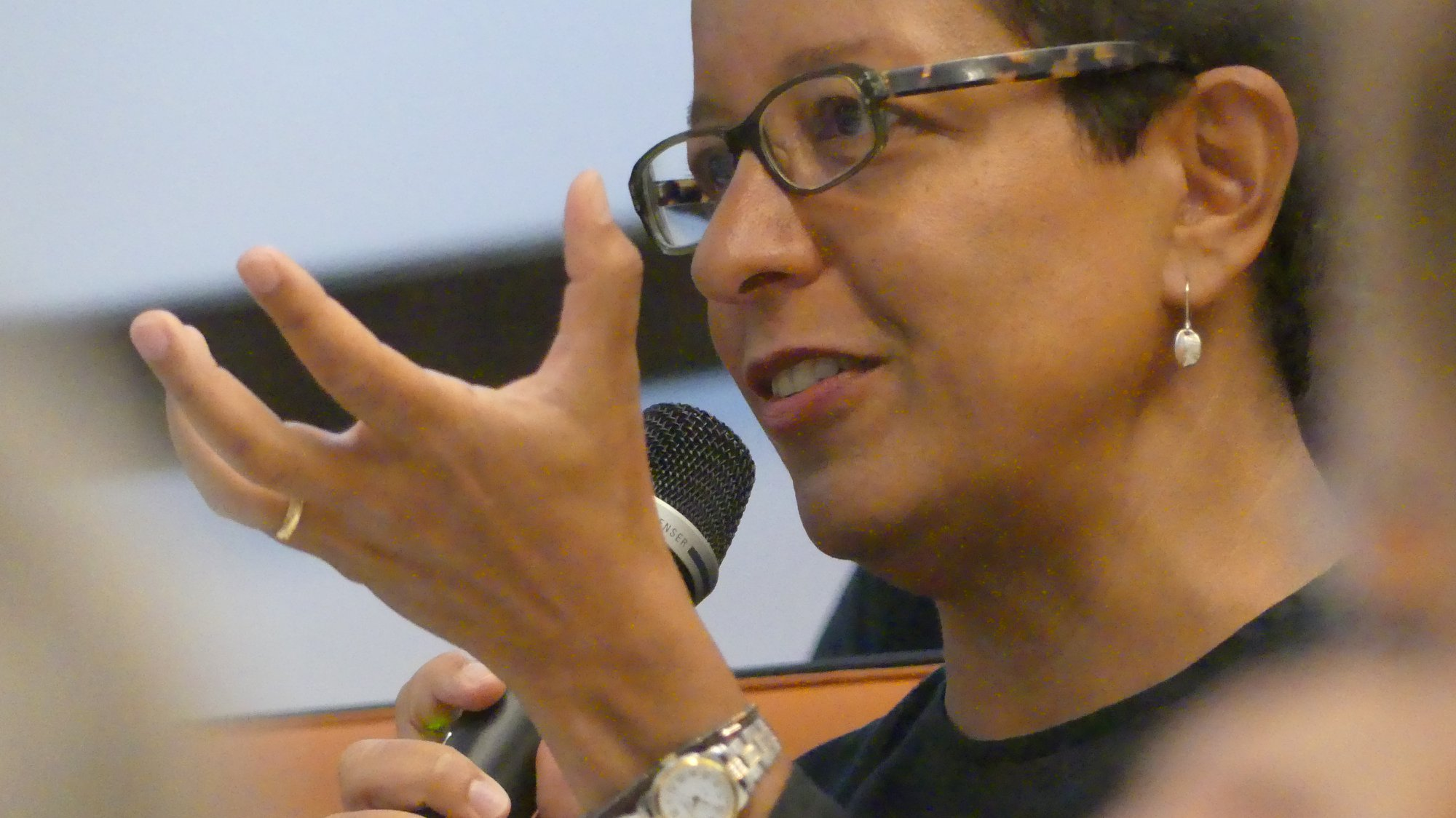 Almaz Zelleke asking a question at a conference