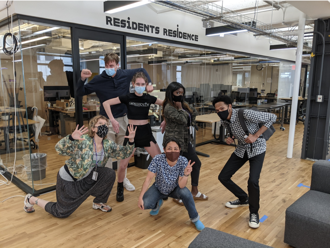 Students strike humorous poses in makerspace