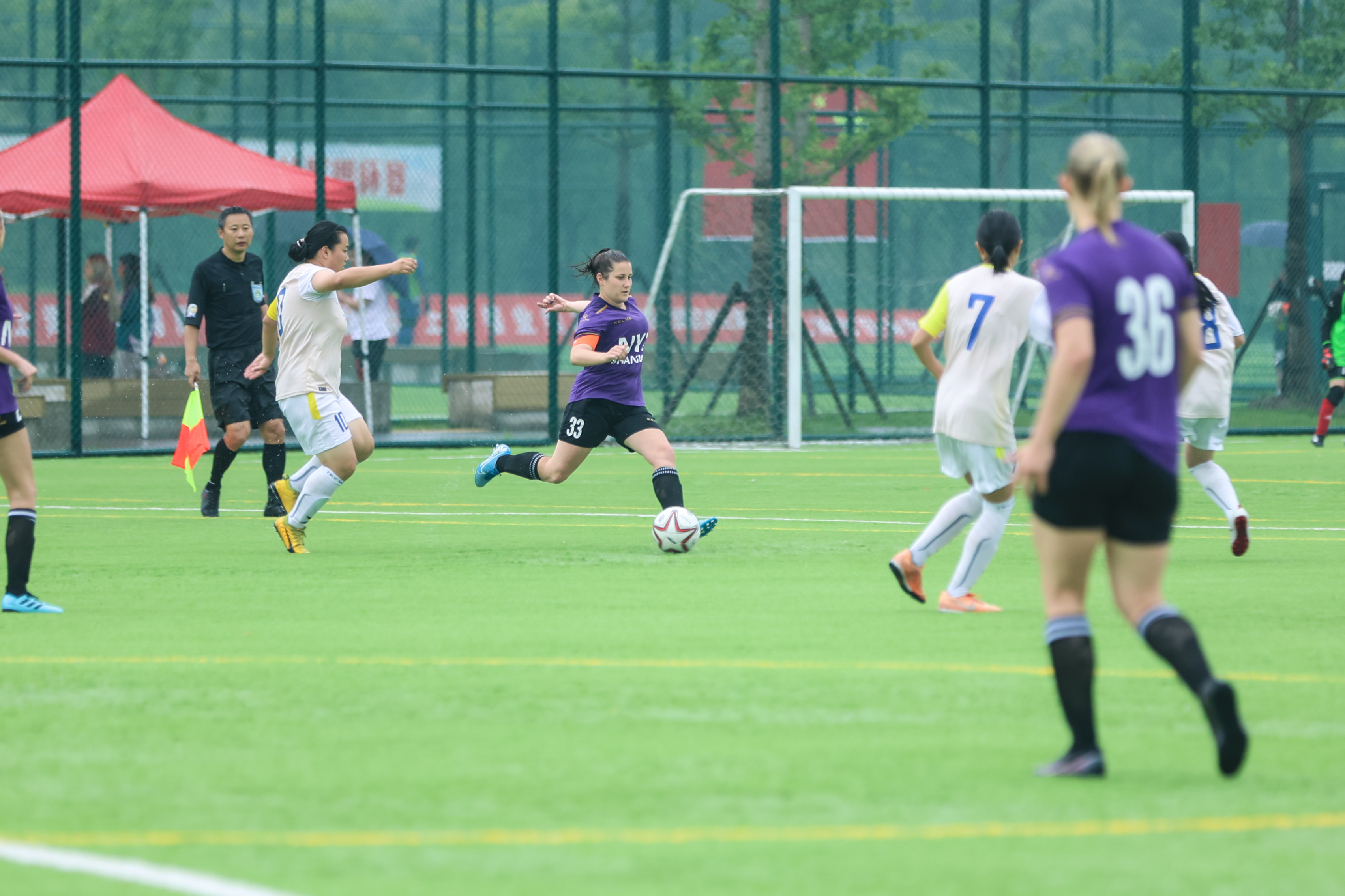 Stephanie Anderson clears the ball from the back