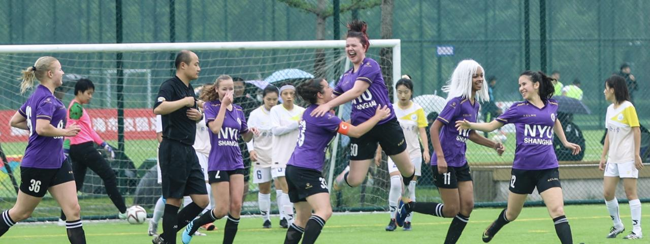 students celebrate after a goal