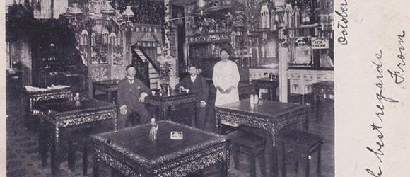 Historical photo of richly decorated Chinese restaurant in late 19th century