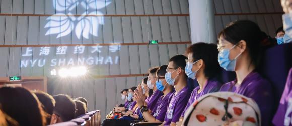 NYU Shanghai spotlight illuminates room filled with students