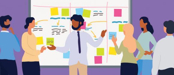 Teacher sharing ideas with peers