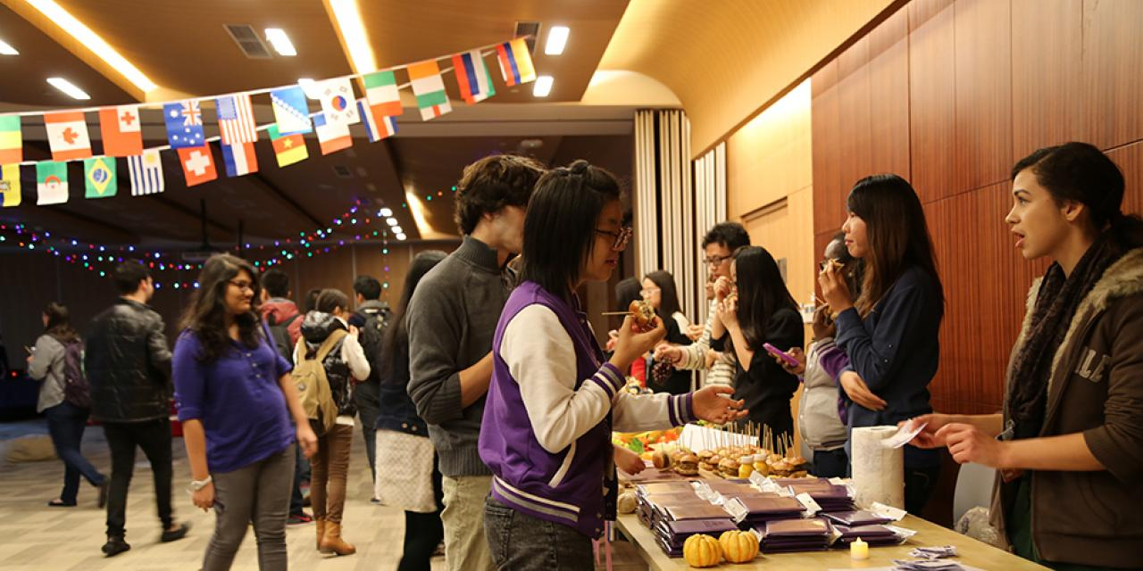 Students explore NYU's global sites at the World Bazaar. November 13, 2014. (Photo by Tong Wu)