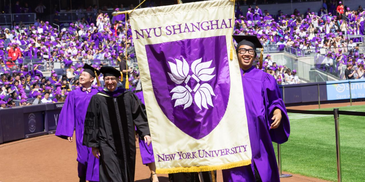 NYU Shanghai seniors Roxanne Roman, Kevin Pham and Zhang Zhan, represented NYU Shanghai at the All-University Commencement at Yankee Stadium on May 17. Pham was NYU Shanghai's banner bearer, Zhan served as the school representative, while Roman gave the student address. (Photos by: NYU Photo Bureau)