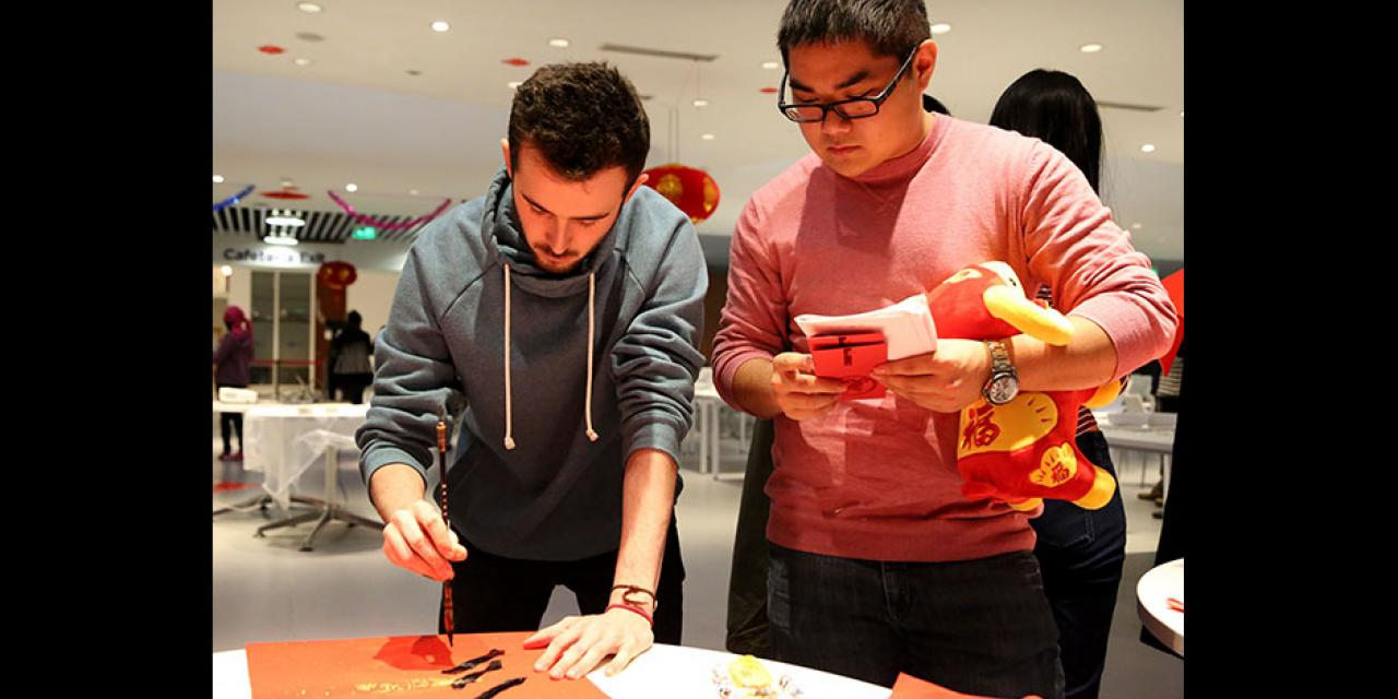 In honor of China's annual Lantern Festival, which marks the last day of Lunar New Year celebrations, students participate in paper cutting, learn Chinese calligraphy, and cook traditional tangyuan (汤圆). March 5, 2015. (Photo by Sunyi Wang)