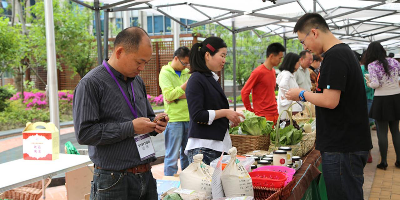Yi Xiaowu (易晓武), organizer of the Fang Cun Di (方寸地) farmers' market, brings her eco-friendly products to NYU Shanghai. May 8, 2015. (Photo by Annie Seaman)