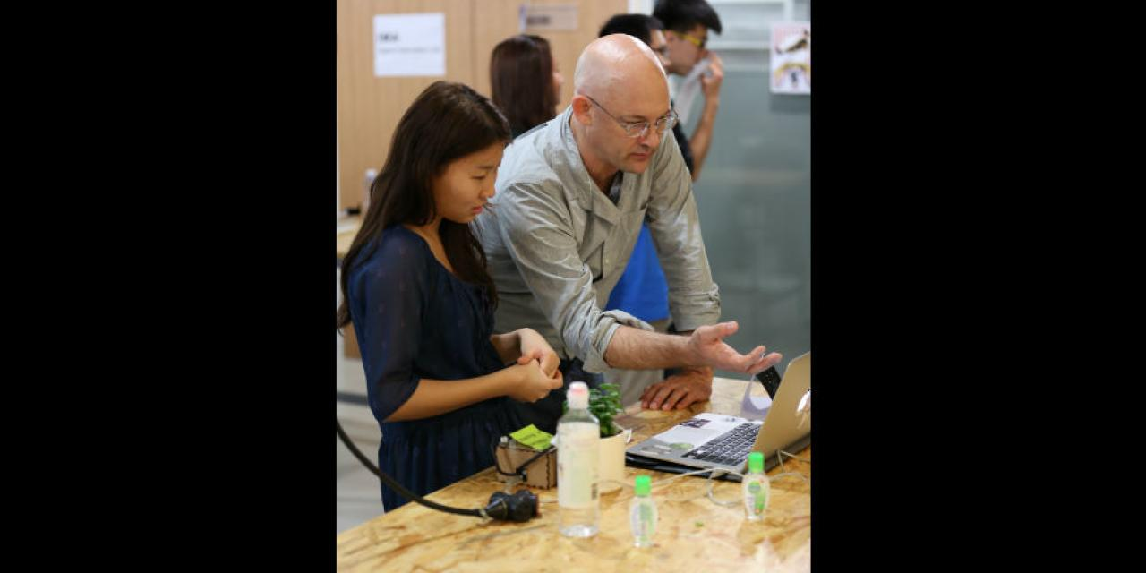 The NYU Shanghai community attends the IMA Spring 2015 End-of-Semester Show, an exhibition of experimental works by the students of IMA's Interaction Lab, Communications Lab, Design Expo, Rapid Prototyping, Talking Fabrics, and Shanghai Streetfood & Urban Farming courses, plus participants of the Autodesk / IMA Smart Home Design Challenge. May 15, 2015. (Photo by Dylan J Crow)