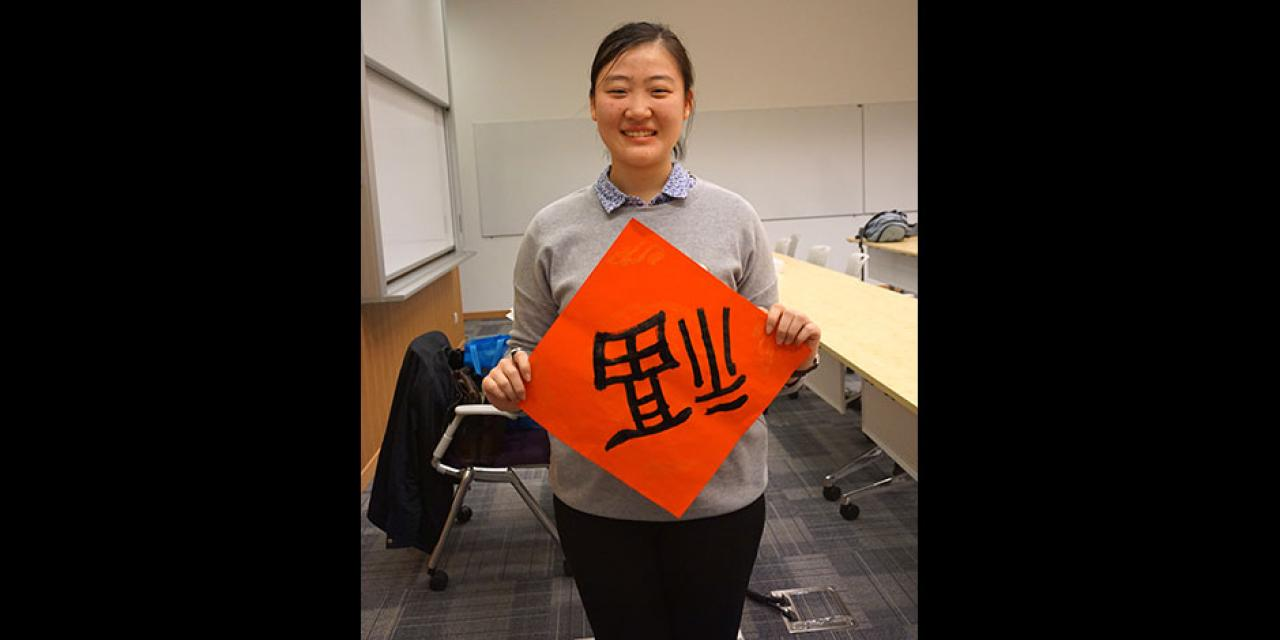 Students prepare for the Year of the Sheep with Chinese New Year writings. February 13, 2015. (Photo by Mei Wu)
