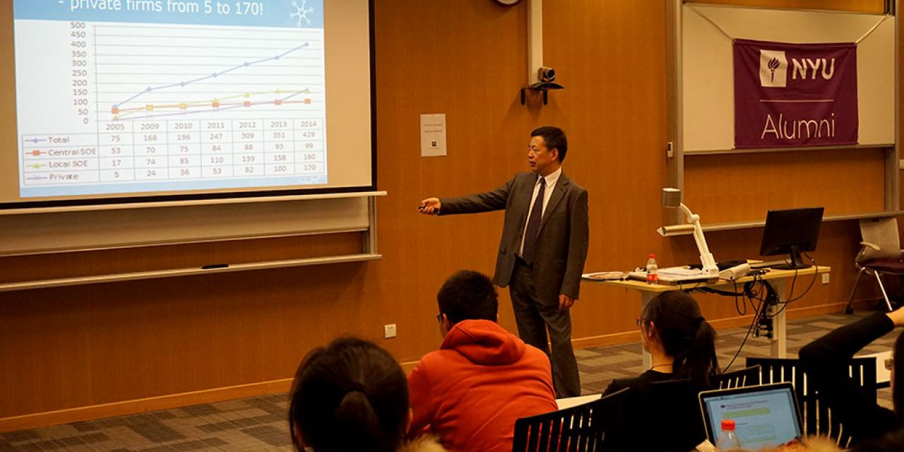 NYU Stern alumnus Woody Wu (Stern Ph.D. '92) speaks to NYU Shanghai students at the Distinguished Alumni Lecture Series. Wu discussed how the country's increased number of Fortune Global 500 companies drove China's GDP development in the last few decades. March 11, 2015. (Photo by Tingting Wang)