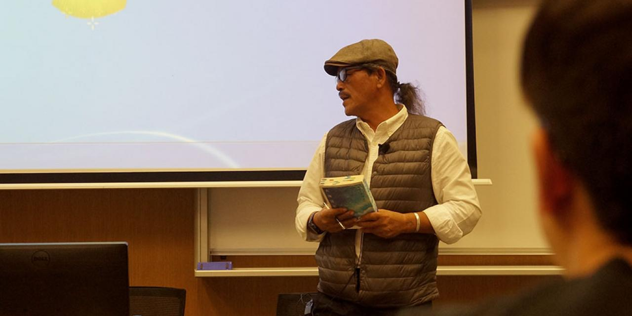 Syaman Rapongan, award-winning writer from the indigenous Tao tribe of Orchid Island, reads excerpts from his latest book, 'Dream Ocean.' April 22, 2015. (Photo by Charlotte San Juan)