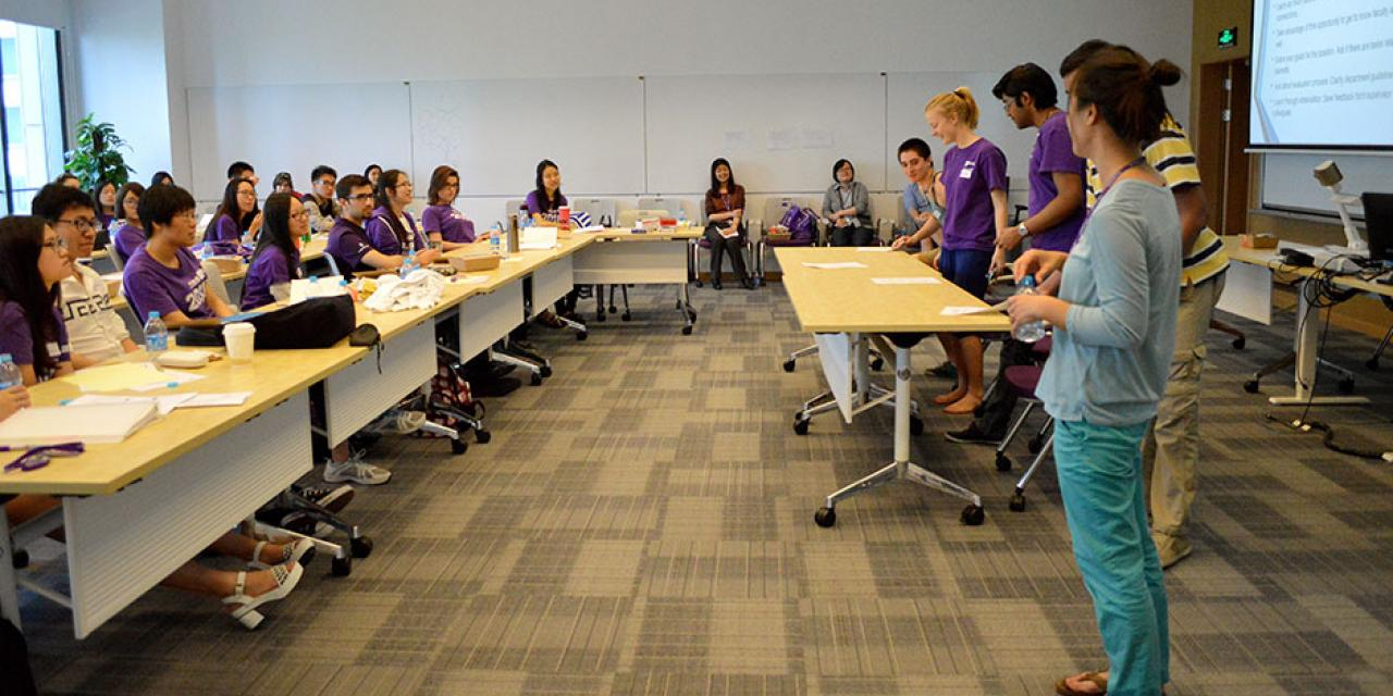 To prepare themselves for video calls with the incoming Class of 2019, Orientation Ambassadors act out a mock Skype session. April 25, 2015. (Photo by Shelly Lu & Joyce Tan)