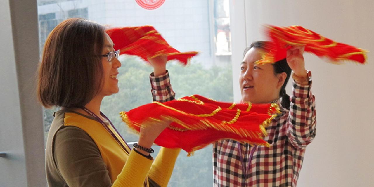 Student activities marking the celebration of Chinese New Year included paper-cutting craft workshops, games and scroll painting. (Photo by: NYU Shanghai)