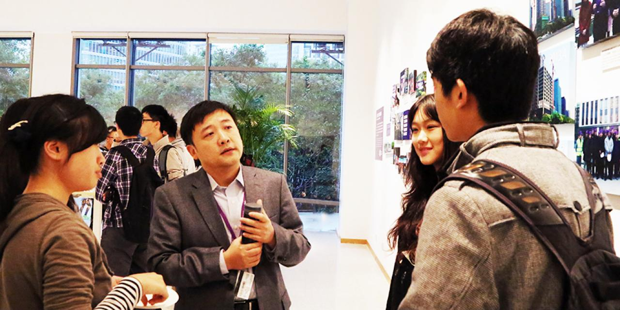 Students discuss their business studies with the Vice Dean of Business, Yuxin Chen, October 16, 2014. (Photo by Annie Seaman)