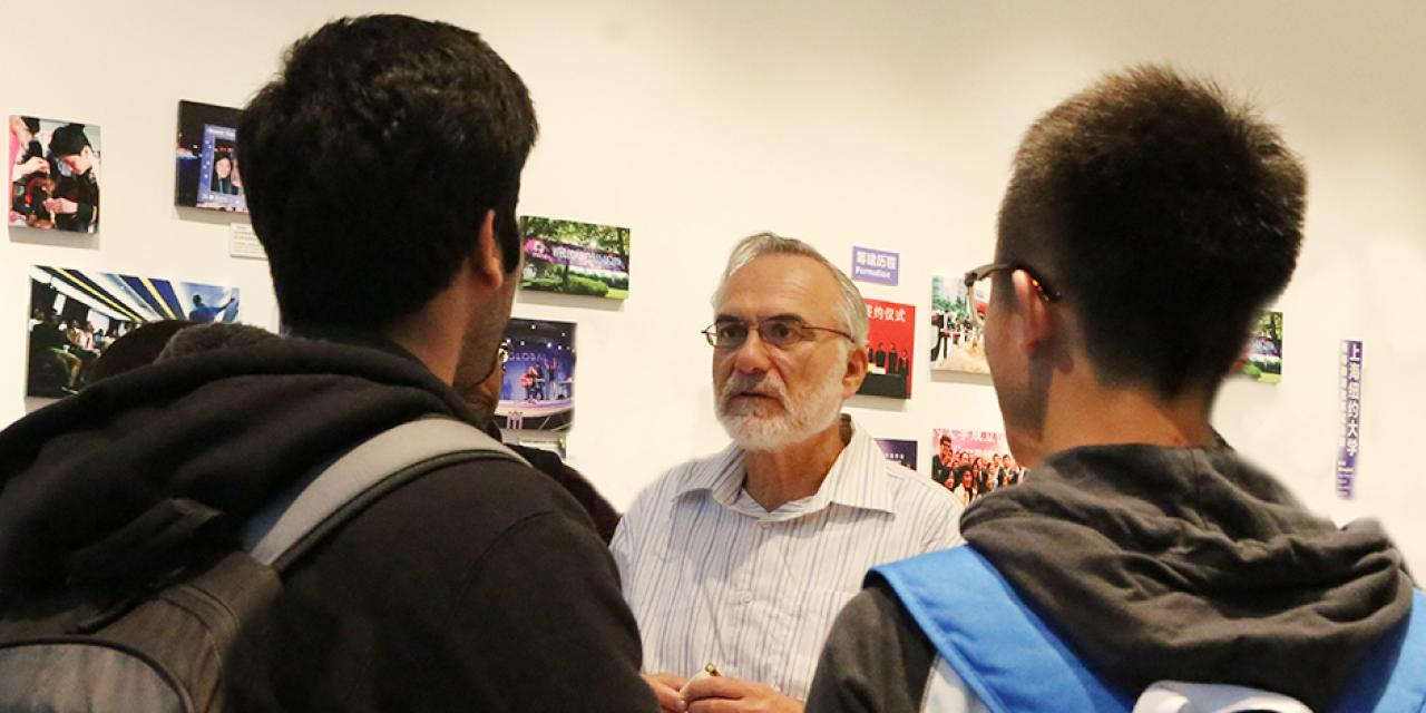 Students discuss their business studies with the Dean of Business, Eitan Zemel, October 16, 2014. (Photo by Annie Seaman)