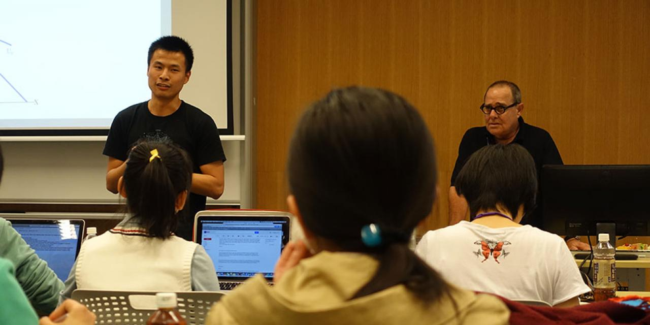 Professor Moshe Kim speaks on the relationship between economics and mathematics. November 24, 2014. (Photo by Yilun Yan)