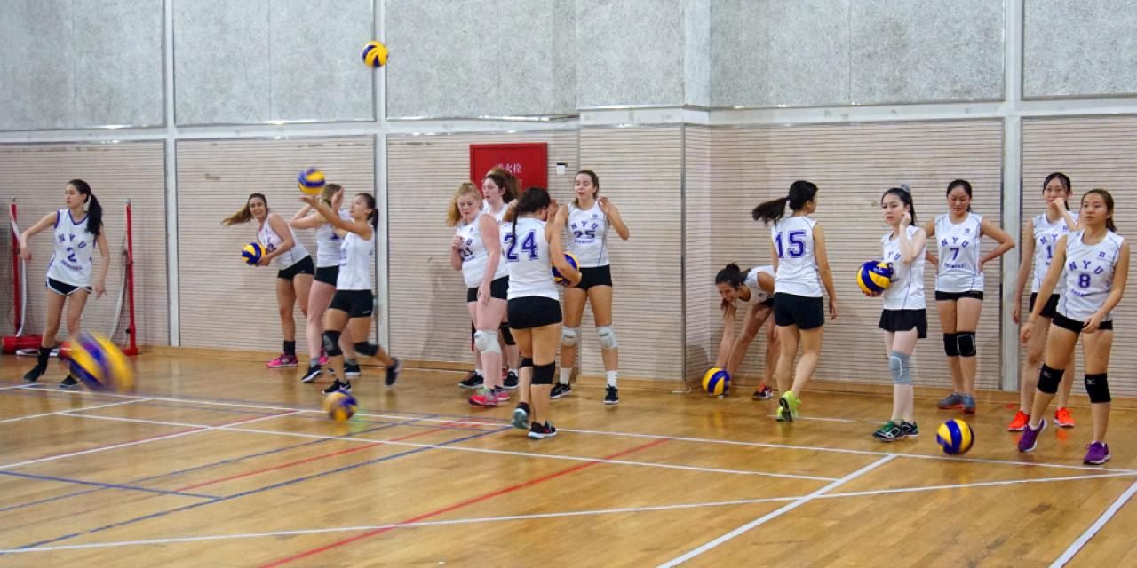 The NYUSH Women's Volleyball team took to court against ENCU, losing out to the partner school on October 20. The team warms up. (Photos by: Nacole Abram)