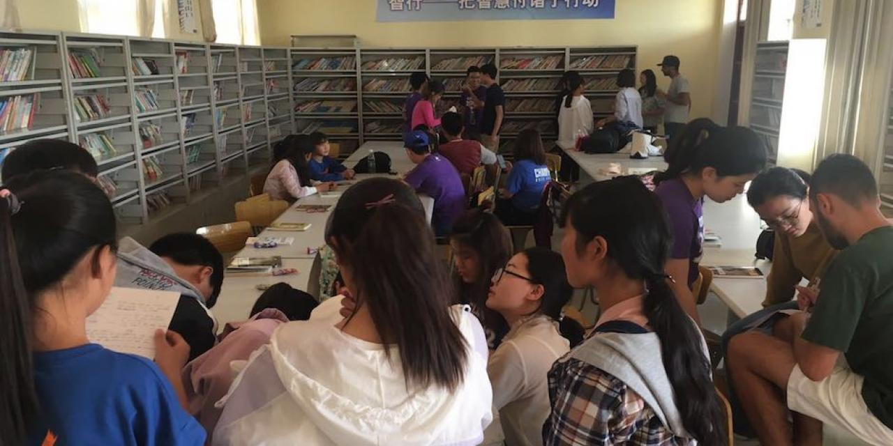 On Sept 30, NYU Shanghai volunteers also visited a local elementary school, working with children in groups to create and perform short English plays. (Photo by Harrison Cheng).