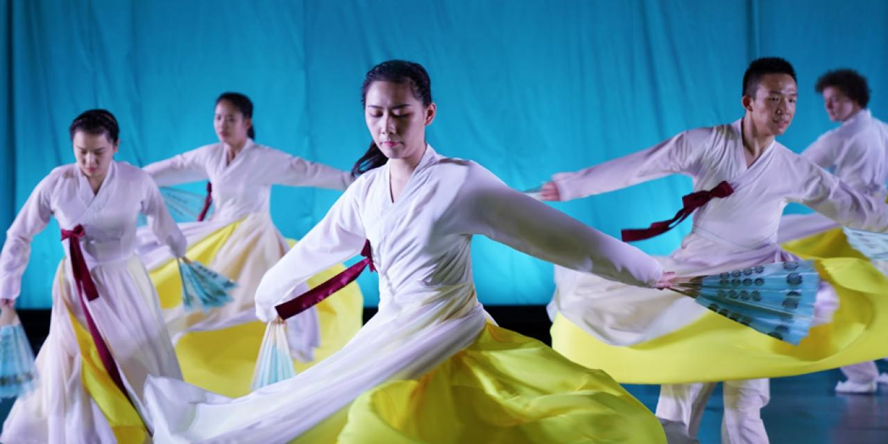 "Wang Yinqi '22, Li Qiaowei '22, Kathy Kaixin Song '22, Yao Yumo '22 and Jaeven Aylor '21 create waves of graceful movements during ""Cranes,"" a Korean fan dance."
