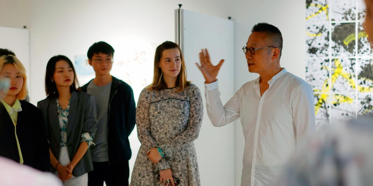 Arts professor Jian-Jun Zhang introduces student works showcased at the 12F gallery. The exhibition hosted artwork from Introduction to Studio Art: Dunhuang Then to Now, and Chinese Gardens in Art: Nature and Culture--Tradition to Contemporary.
