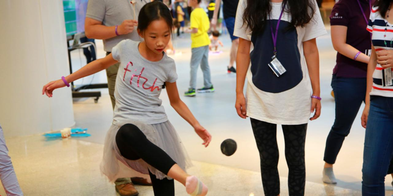 Families of NYU Shanghai faculty and staff gathered on September 10 for a morning of activities ranging from hula hoop challenges to competitive team calligraphy. (Photo by: NYU Shanghai)