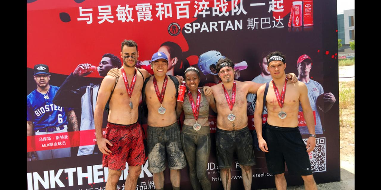 On Sunday May 21st, five NYU Shanghai students competed in the Shanghai Spartan Sprint. The race consisted of a 6.7 kilometer course with 23 obstacles ranging from rope climbs to barbed wire crawls. The journey was difficult, but these students were proud to represent NYU Shanghai. During their time as NYU Shanghai students, these five have faced many obstacles. However just like during the race on Sunday, unity and teamwork propelled everyone through the finish line. The students are as follows from left to right: Louis Demetroulakos 19', Jimmy Kim 17', Olivia Taylor 17', Jarred Kubas 17', and Alex Mayes 17'.