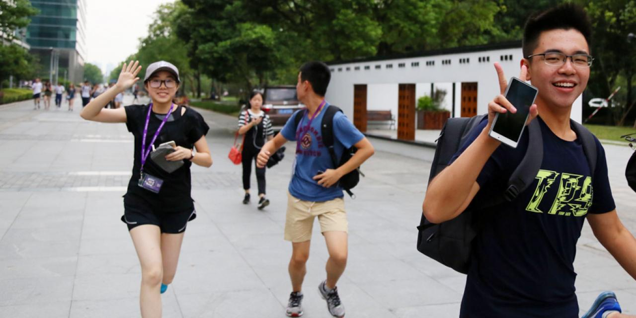And they're off! Freshmen students get a running start on the Amazing Race, as they scatter all over Shanghai to compete at solving puzzles and completing photo challenges around The Bund, Jing'an Temple, Century Park, 1933 Shanghai, and the Former French Concession. (Photo by: NYU Shanghai)