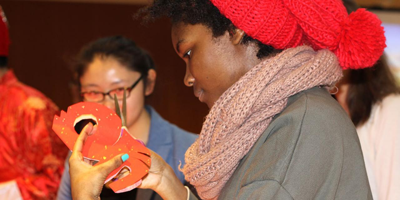 In honor of China's annual Lantern Festival, which marks the last day of Lunar New Year celebrations, students participate in paper cutting, learn Chinese calligraphy, and cook traditional tangyuan (汤圆). March 5, 2015. (Photo by Liming Shi)
