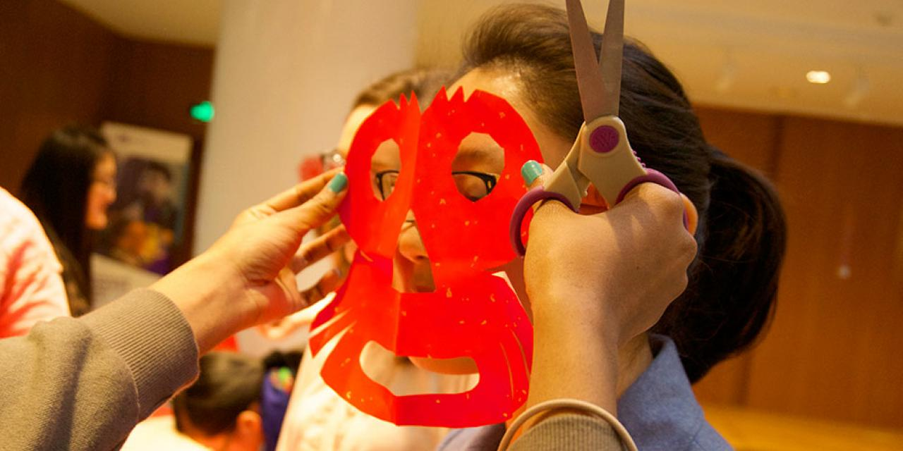 In honor of China's annual Lantern Festival, which marks the last day of Lunar New Year celebrations, students participate in paper cutting, learn Chinese calligraphy, and cook traditional tangyuan (汤圆). March 5, 2015. (Photo by Mei Wu)