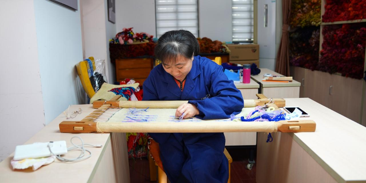 Needlepoint tapestry is a disappearing art form. The center is subsidized by the Shanghai government, and employs 12 craftspeople -- all of whom are in their 60s.