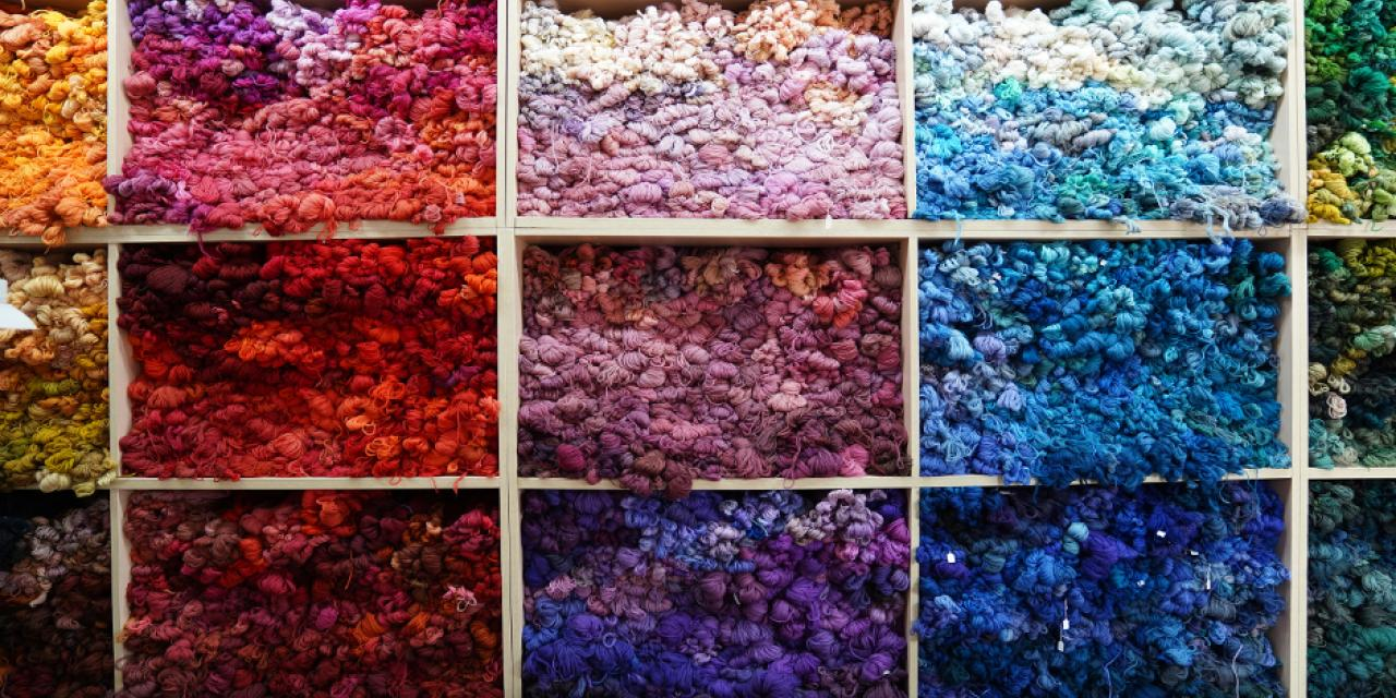 "A wall of hand-dyed yarn. Director Bao explained that all of the yarn used for weaving is hand-dyed in batches ""as small as a bowl of noodles."""