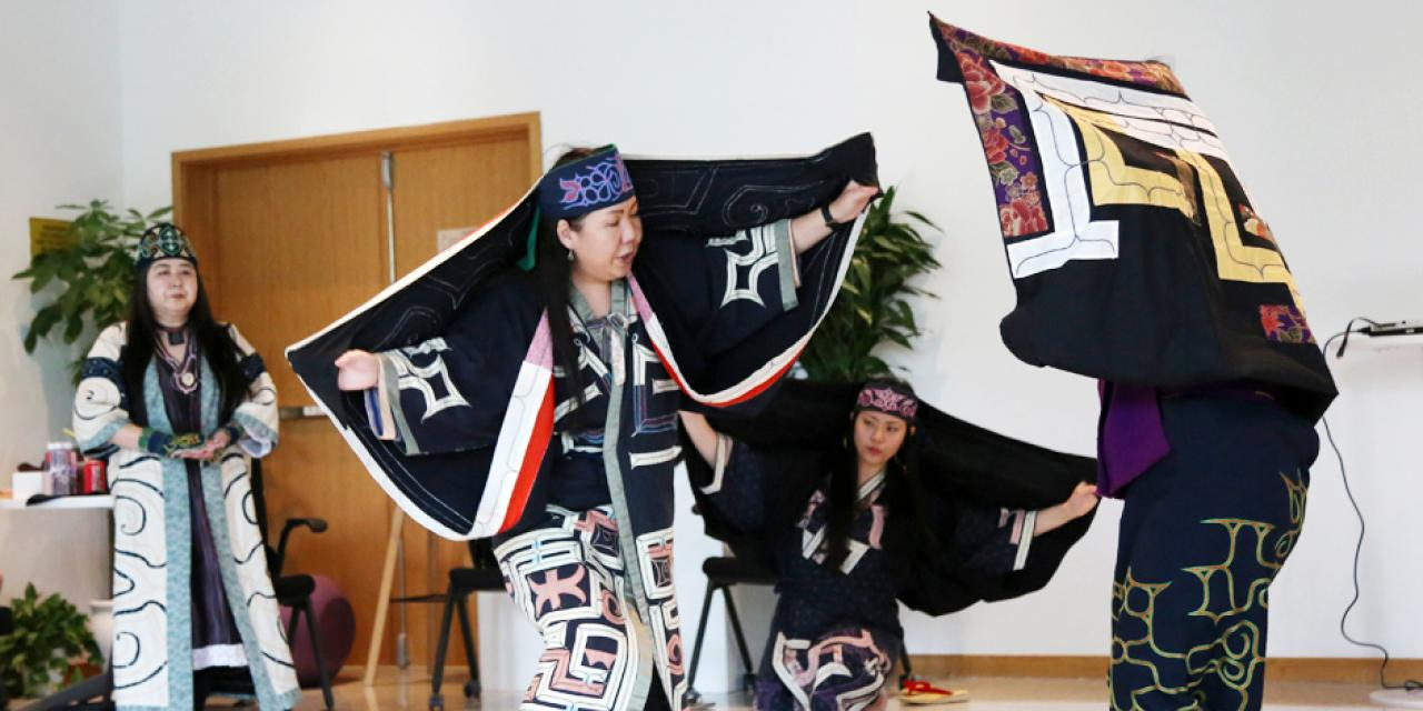 Saron-rimse is a dance in which performers play cranes--the gods of the wetlands of Hokkaido. The older dancers represent adult cranes teaching their young how to dance.