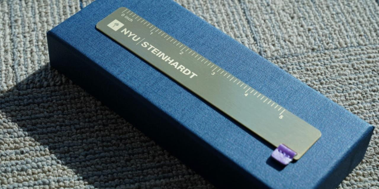 A customized copper ruler co-branded on both sides with the NYU Shanghai logo and NYU Steinhardt or NYU Stern logo was another memorable gift box surprise.