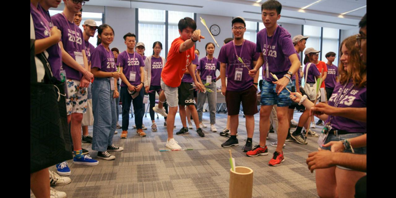 Led by upper-class Orientation Ambassadors (OAs), members of the Class of 2023 show their spirit during a round of the traditional Chinese dart-throwing game, touhu (投壶)--an NYU Shanghai 'Fun Olympics' tradition. The 434 first year students branched off into small groups, each led by one of 36 Orientation Ambassadors. The OAs are experienced NYU Shanghai students who applied and were selected to help new students adjust to the campus's unique cultural and linguistic environment by sharing their own struggles and successes.