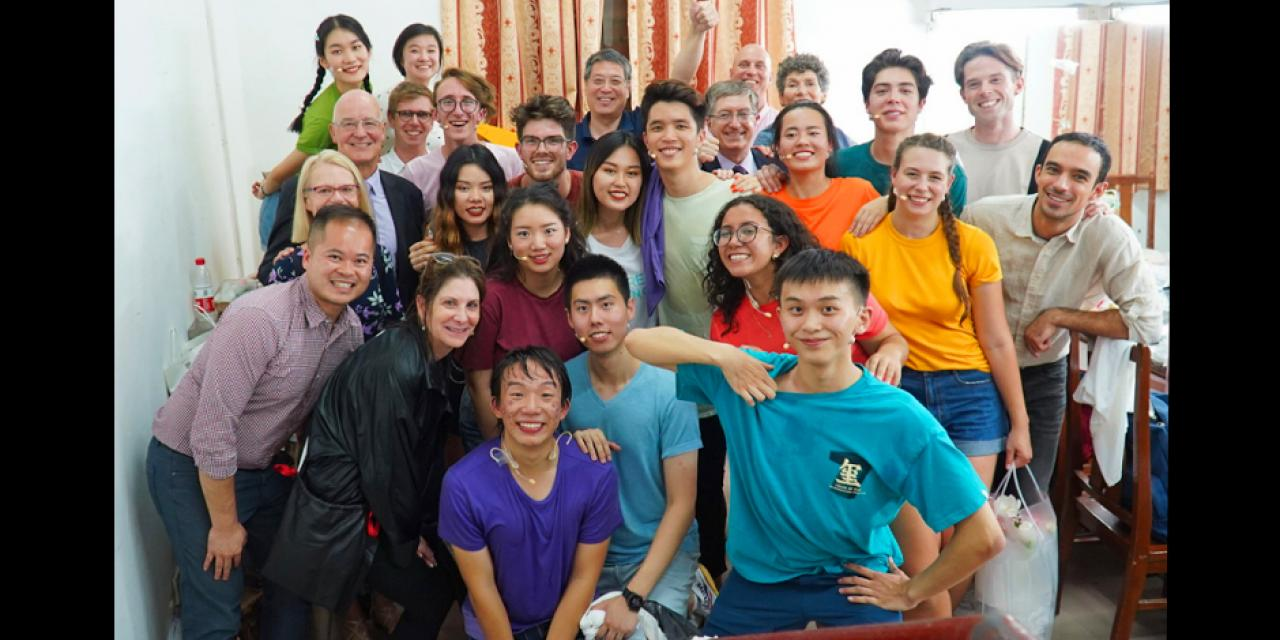Bravo! Cast members celebrate a successful show backstage with NYU President Andrew Hamilton and his wife Jenny, Chancellor Yu Lizhong, and Vice Chancellor Jeff Lehman.