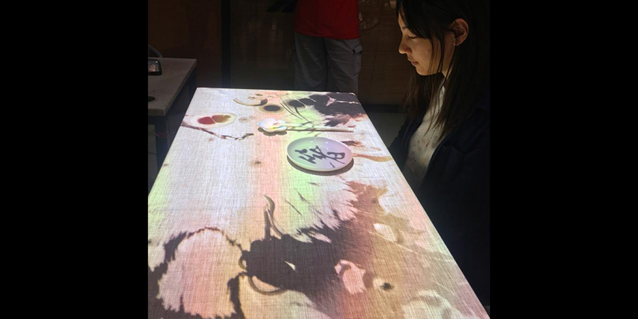 "Project ""Zhu 箸"", developed by Yao Yuxia '18, Zhao Yi '18, Zhao Nan '18 and Wang Weiyu '18, featured interactive chopsticks in a virtual dining experience. Inspired by the traditions of chopsticks, the student group wanted to draw attention to the cultural heritage of the Chinese utensils. At the same time, IMA Fellow Jack B. Du took mechanical art to a new level with his artist robot, Minus E that painted intricate images pixel by pixel with a sharpie.  (Photos by: Leon Lu and Chen Mengzhu '18)"