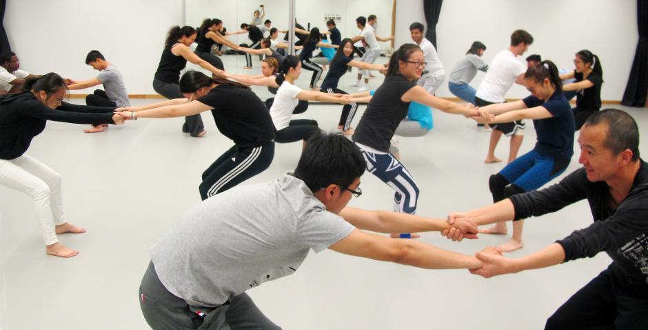 During the dance workshop, students paired up for warm up stretches, working with their partner in a balance of body weight exertion. (Photos by: NYU Shanghai)