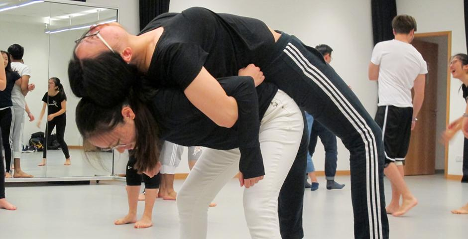 Sweeping through the space in complex patterns, dancers lead their closed-eyed partners by the hand, using energy to convey location in a true exercise of trust. (Photos by: NYU Shanghai)