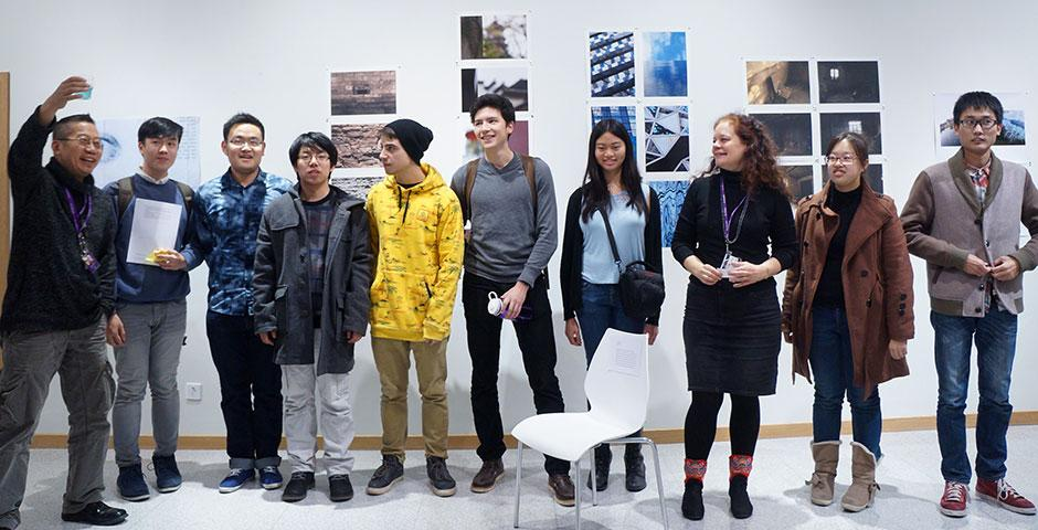 """Professors Barbara Edelstein and Jian-Jun Zhang join their students in showcasing """"Image Ination,"""" an exhibit of original student photography compositions. December 10, 2014. (Photo by Charlotte San Juan)"""