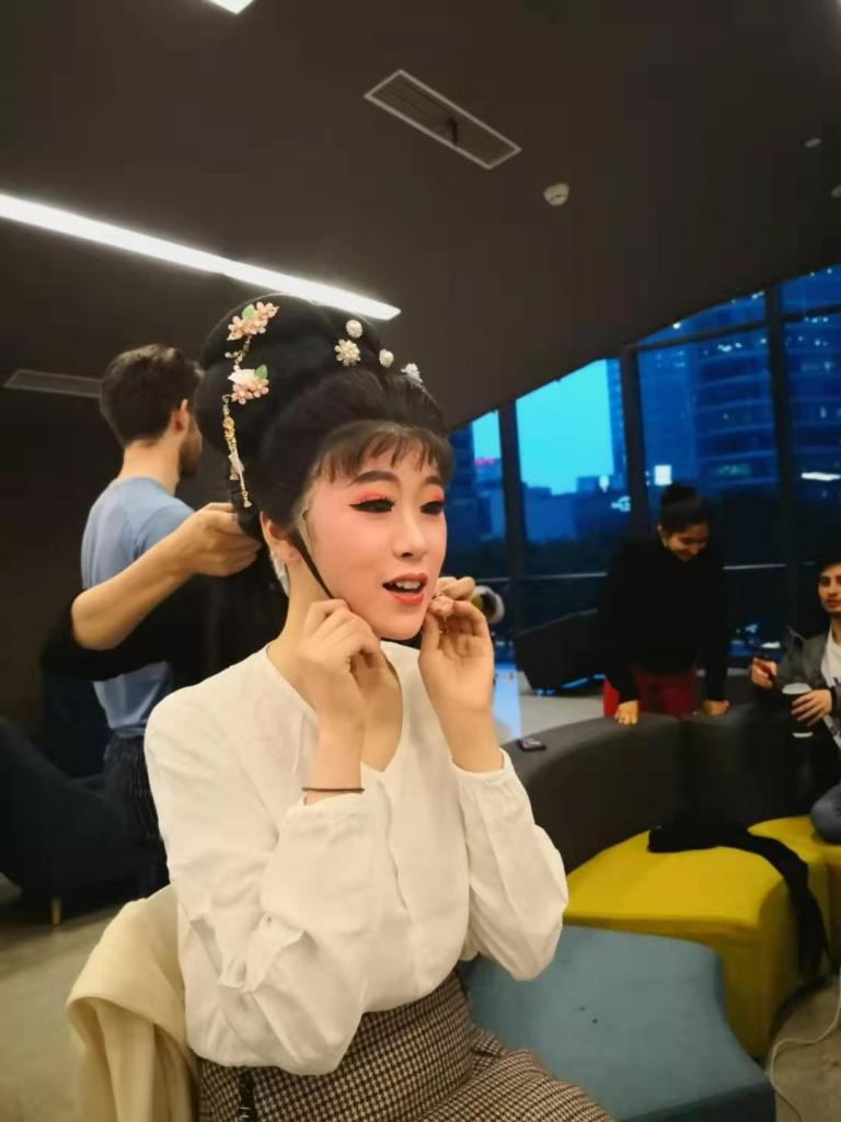 Chen Nuo '22 puts the finishing touches on her make-up before her Peking opera performance.