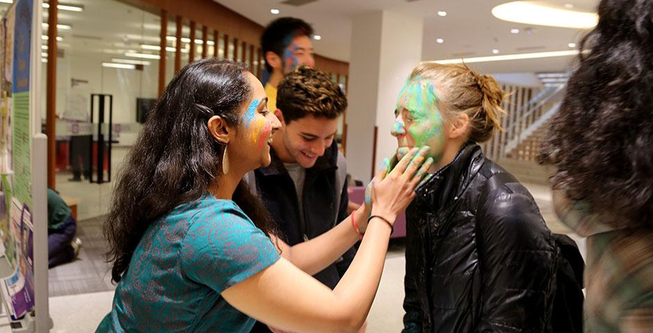 To celebrate Holi Festival, a Hindu festival with colored powder and water fights, the Food and Festivals Club dusts students' faces with colored chalk. March 6, 2015. (Photo by Annie Seaman)