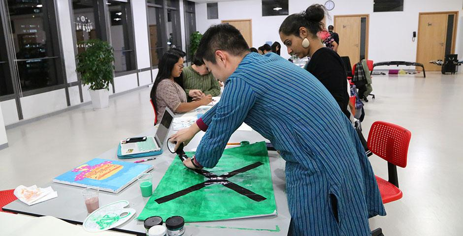 Students participate in NYU Shanghai's first-ever Festival of the Arts, which featured a creative open studio, masterclasses that taught dance, theater, and singing, and talks with local artists. March 6-8, 2015. (Photo by Annie Seaman)