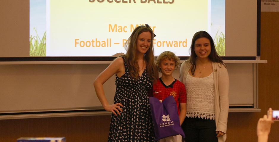 As part of Ally Week 2015, young soccer fan and player Mac Millar speaks at NYU Shanghai on promoting peace through his favorite sport. April 13, 2015. (Photo by Annie Seaman)