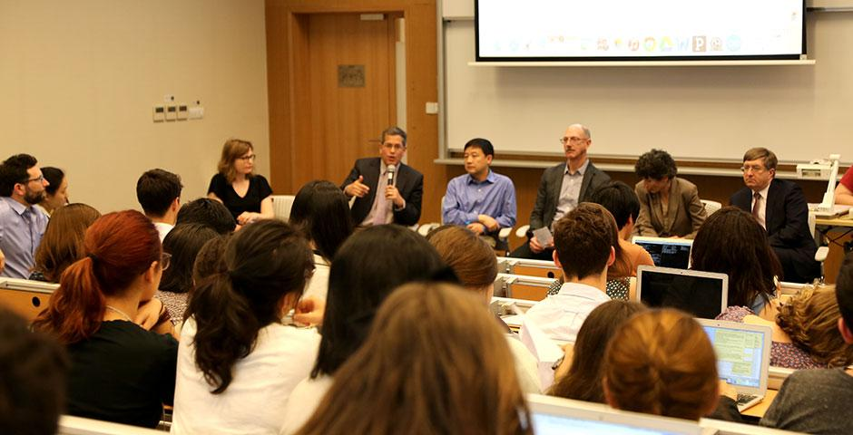 NYU Shanghai faculty gather for a forum discussion covering important academic topics such as major requirements, study away restrictions, e-books, and more. May 7, 2015. (Photo by Annie Seaman)