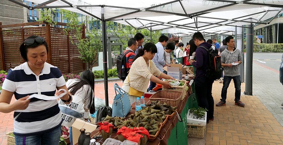 Yi Xiaowu (易晓武), organizer of the Fang Cun Di (方寸地) farmers' market, brings her eco-friendly products to NYU Shanghai. May 8, 2015. (Photo by Annie Seaman)