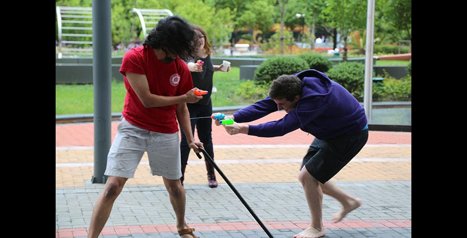 Students wrap up Stressbusters Week with an outdoor fiesta of watergun fights, pizza, and music. May 16, 2015. (Photo by Kevin Pham)