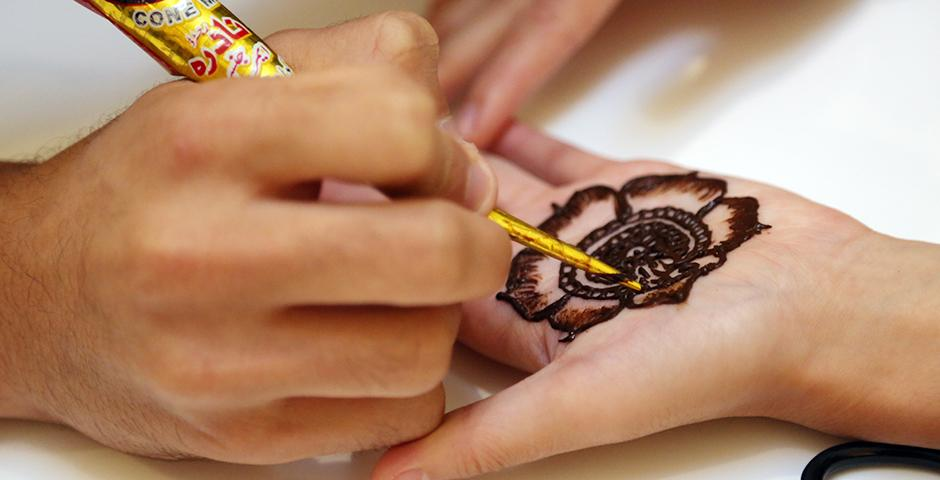 The Eid Festival was on September 24th, 2015. At the event, students got a taste of a variety of foods, have volunteering students apply henna, try some traditional bangles, and enjoy a multitude of different music styles. (Photo by Shikhar Sakhuja)