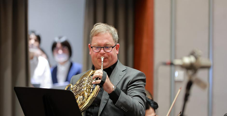 """On December 14, the NYU Shanghai Orchestra, the Choir, Jazz Ensemble, and faculty joined forces for an end of semester concert.  Here Affiliated Associate Professor Alex Ruthmann plays """"Intermezzo from L'Arlesienne Suite No. 2"""" by Georges Bizet on the french horn."""