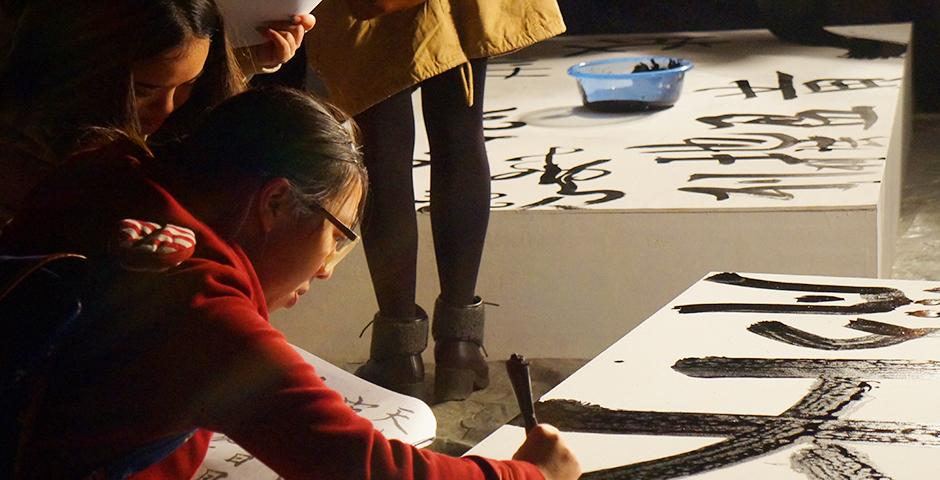 """Fifteen studio art students selected by Jian-Jun Zhang and Barbara Edelstein collaborated in the installation of their piece, """"Vestiges of a Process: Flowing Ancient Poem,"""" at the Long Museum on November 26 (Photos by: NYU Shanghai)"""