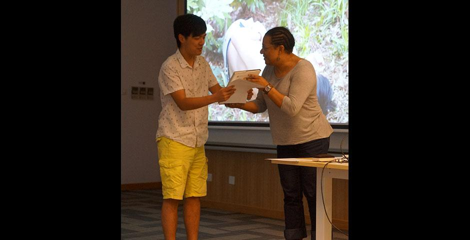 """Professor Anjuli Pandavar's 'EAP: Cities and Urban Consciousness' students showcase their """"secret video"""" projects and receive certificates of achievement for their hard work. May 14, 2015. (Photo by Charlotte San Juan)"""